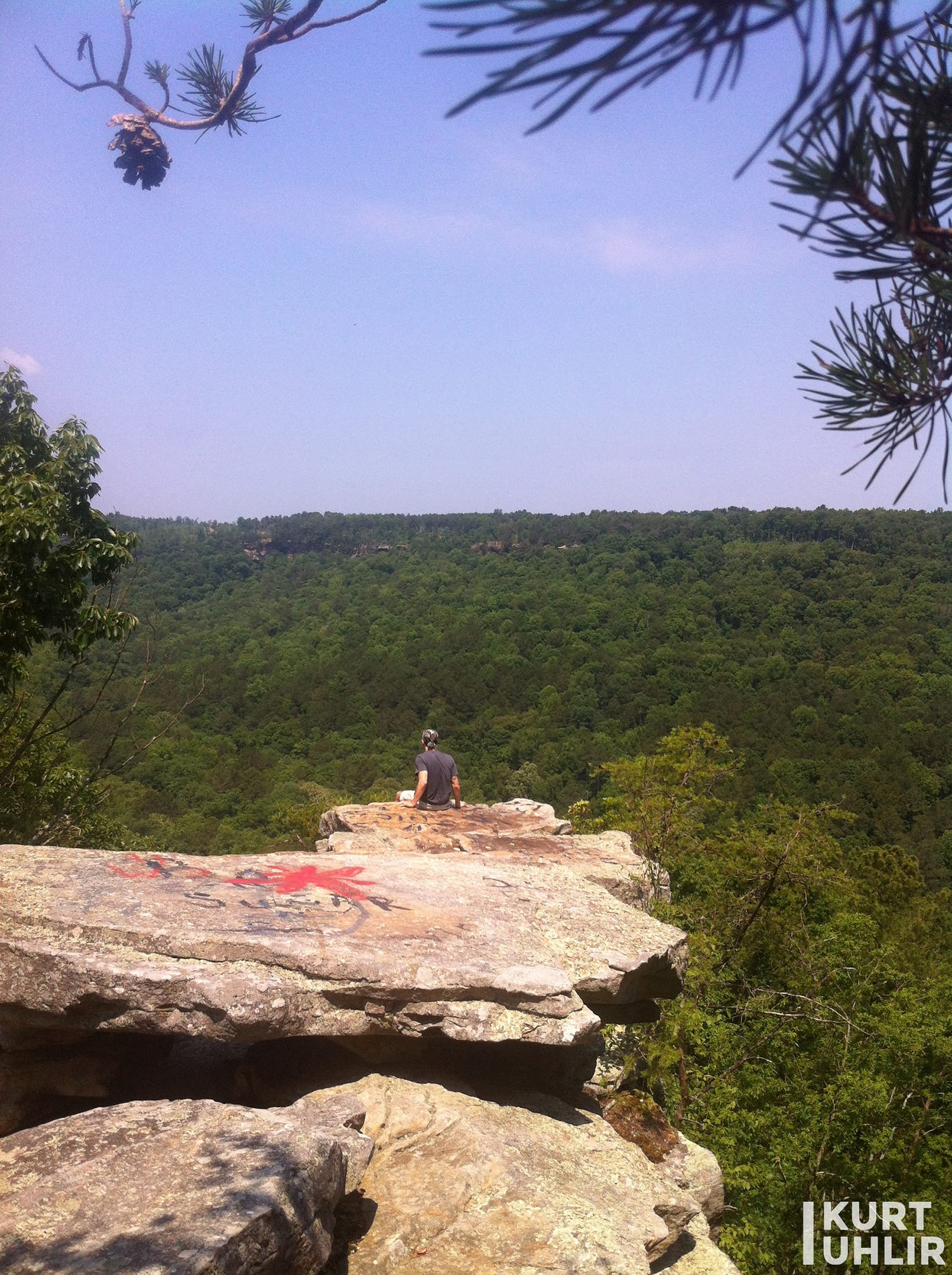 Kurt Uhlir sitting on cliff at Bucks Pocket State Park in Alabama