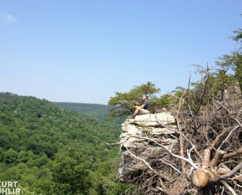 Kurt Uhlir sitting on cliff at Bucks Pocket State Park in Alabama
