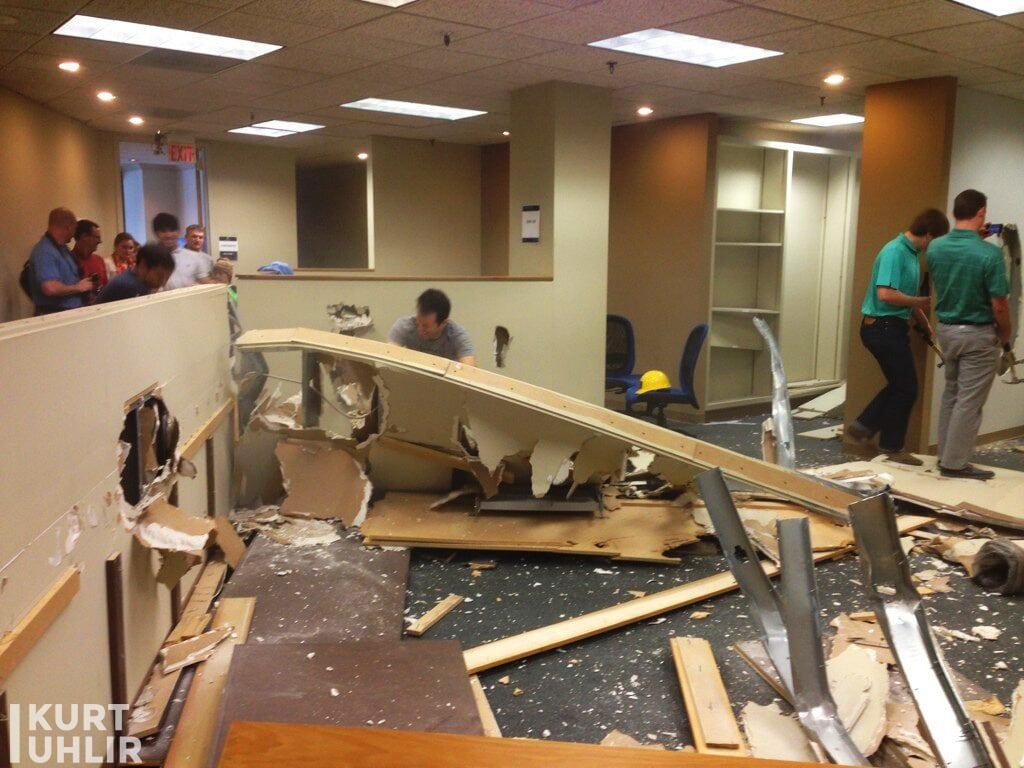 Atlanta Tech Village demolition party - Kurt Uhlir pushing down cube wall