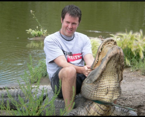 "Kurt with 10.5"" alligator he pulled out of a pond."
