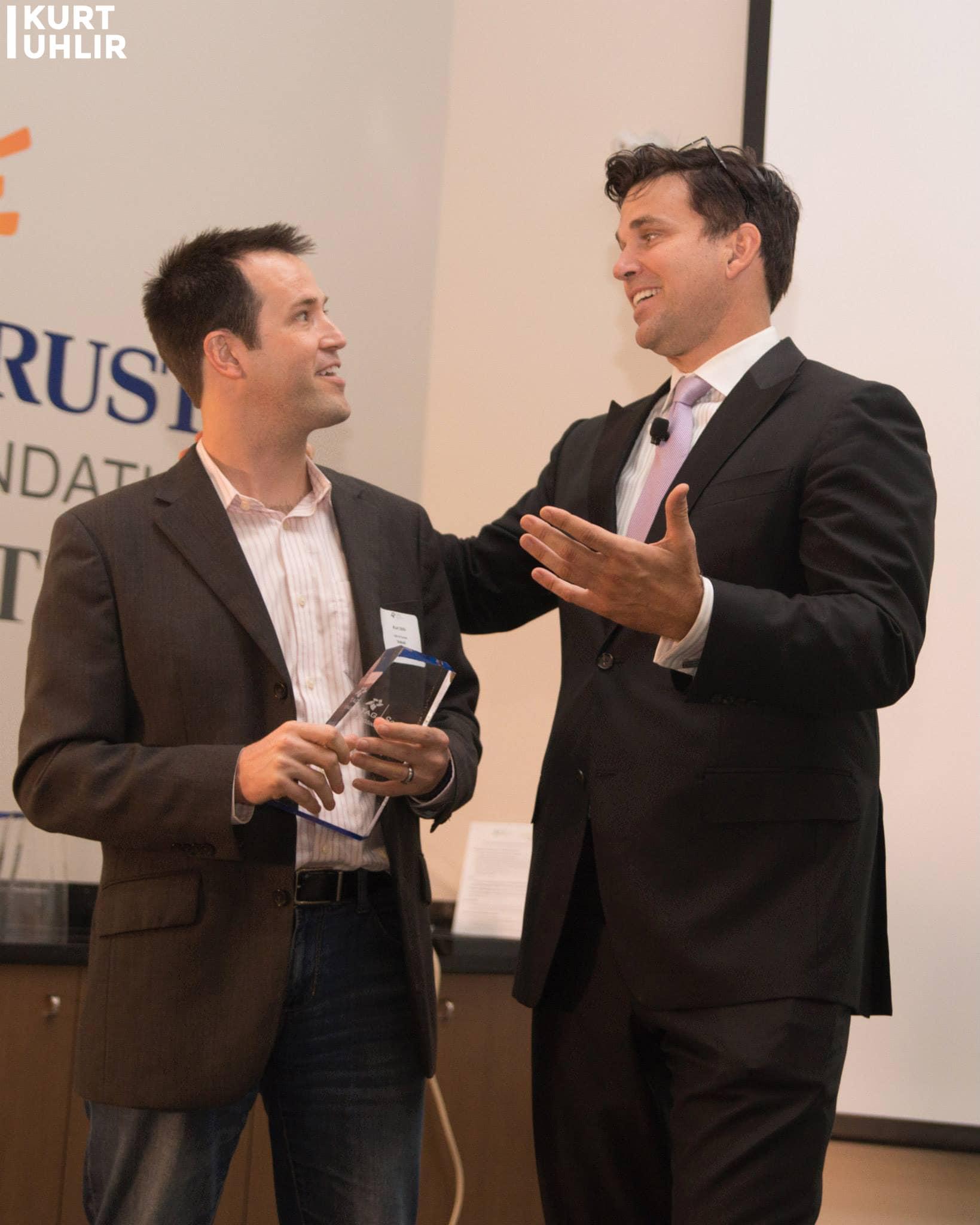 Kurt Uhlir with Conn Jackson. After accepting award for Sideqik leading the evolution of partnership marketing into influencer marketing. 2014 TAG Social Savvy Awards - Technology Association of Georgia