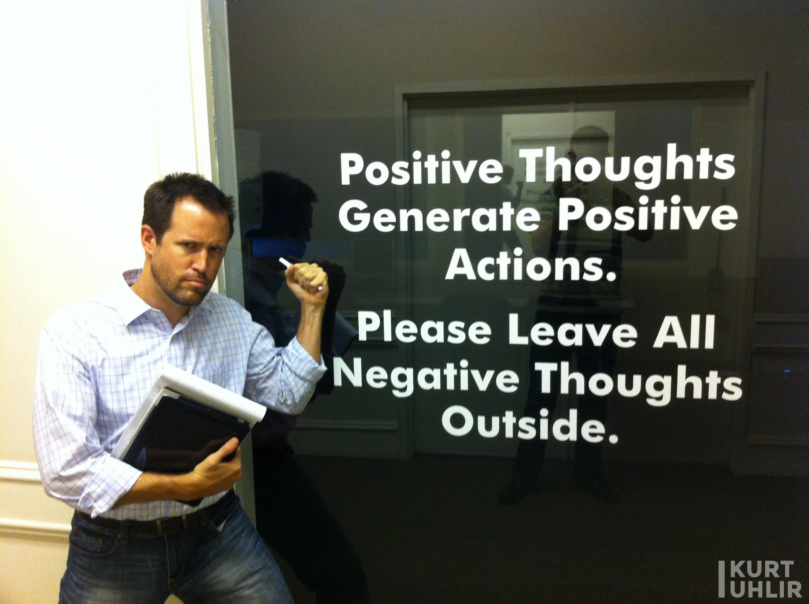 Kurt Uhlir having fun while doing customer discovery. Sign - Positive thoughts generate postive actions. Please leave all negative thoughts outside.