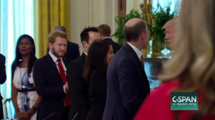 President Trump shaking hands with Margarita Mendoza